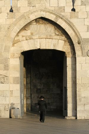 orthodox jew entering jerusalem old city through the jaffa gate photo