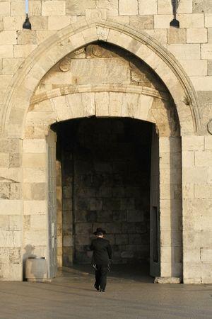 orthodox jew entering jerusalem old city through the jaffa gate Stock Photo - 3918505