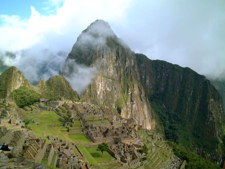 conquest: light cloud crossing macchu picchu on a sunny day, peru