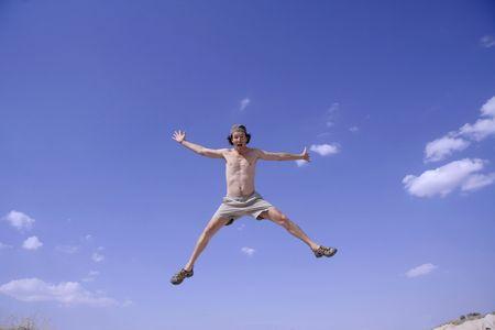 healthy happy man jumping in joy of life Stock Photo - 3927925