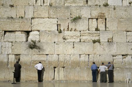 men praying next to the wailing wall, jerusalem,israel Stock Photo