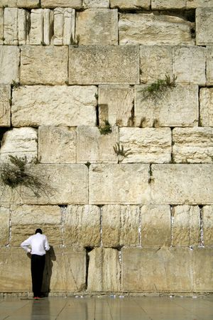 hasidic: man praying next to the wailing wall, jerusalem,israel