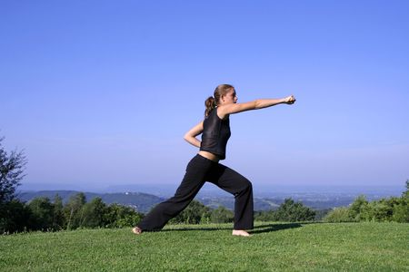 self defence: punch - attractive young woman practising self defense