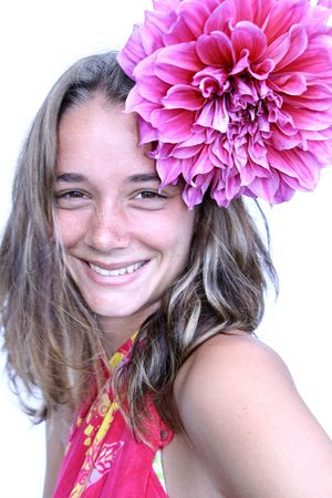young woman with flower in hair photo