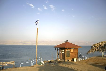 israeli flag floating above a shack at a dead sea resort Stock Photo - 3925797