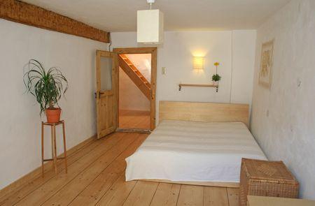 lumber room: bedroom with wooden floor