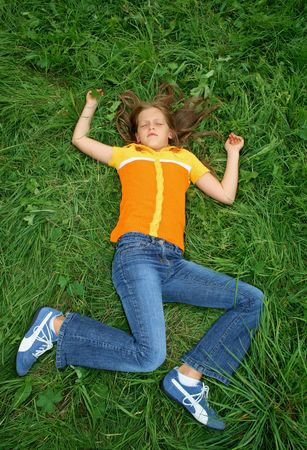girl lying on her back in strange pose, either sleeping, injured or dead Stock Photo