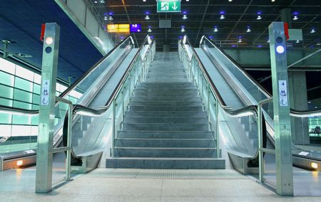 rapid steel: stair and escalators in a public area Stock Photo