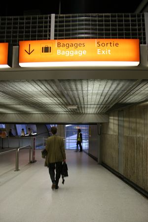 baggage claim sign in airport photo