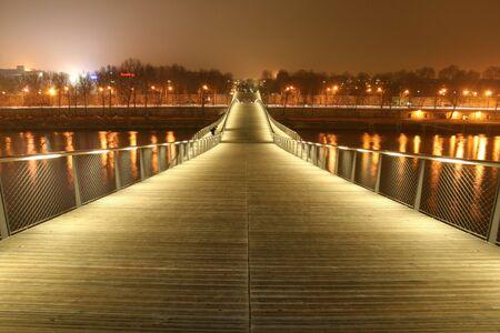 simon de beauvoir footbridge at night, paris, france photo