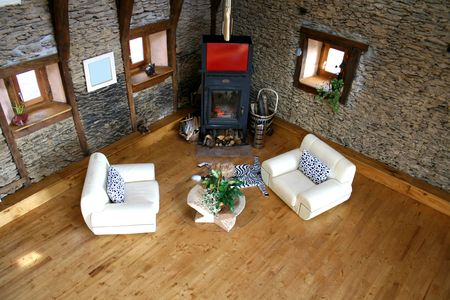place of living: above view of living room with fireplace and cat on rug Stock Photo