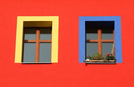 neighbour: red wall, yellow and blue window frames