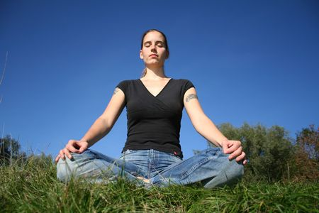 woman meditating in sun photo