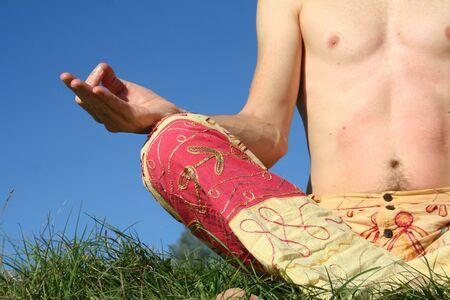 man sitting in chin mudra photo