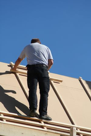 slate roof: bald roofer Stock Photo
