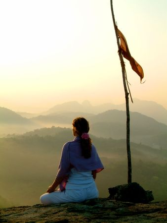 lady meditating at sunrise photo