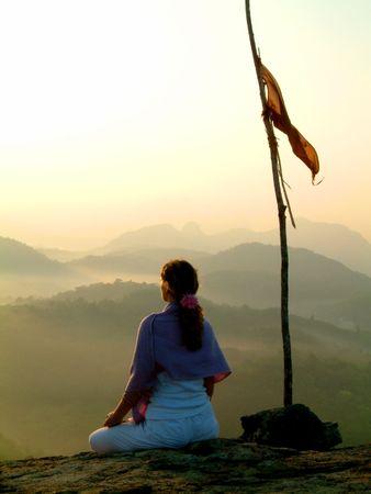 subcontinent: lady meditating at sunrise