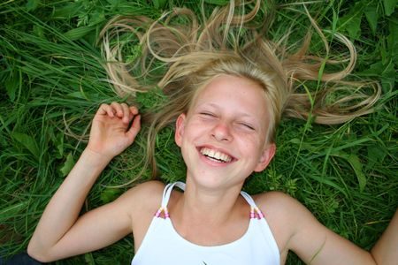 young blonde girl laughing in grass Stock Photo - 3966584