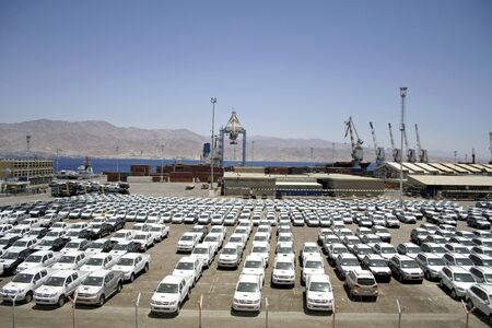 importation: new cars lined up in the port of eilat, israel