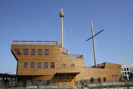 wooden galleon mast on blue sky photo