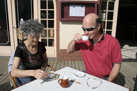 retired couple enjoying a coffee in the sun Stock Photo - 3936993