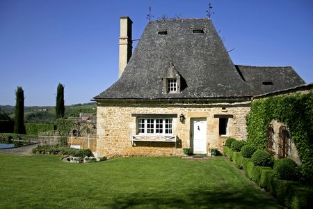 old renovated stone house and garden photo