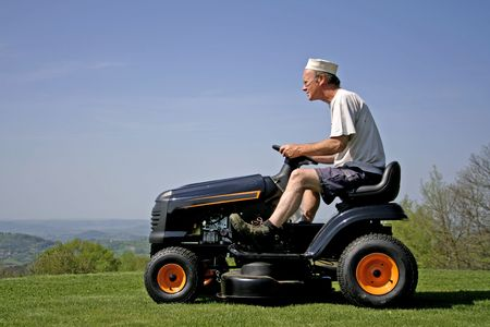 man sitting on lawn mower photo