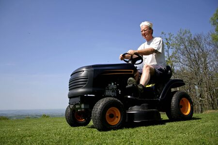 man sitting on a lawnmower Stock Photo - 3936954