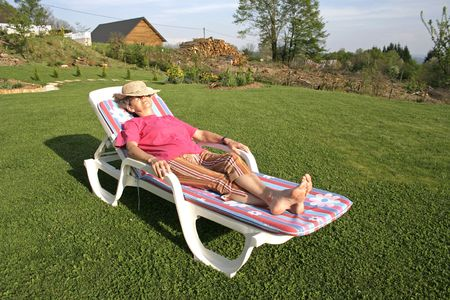 lounger: woman pensioner enjoying her free time in garden