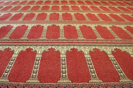 red arabian floor carpet in mosque photo