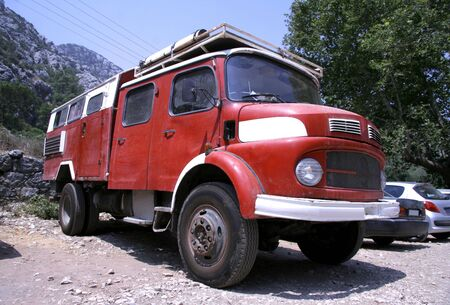 campervan: red fire truck converted into a campervan