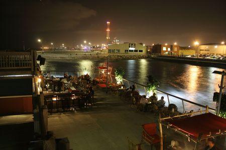 side bar: people sitting on bar terrace tel aviv Stock Photo