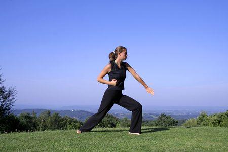 self defense: attractive young woman practising self defense Stock Photo