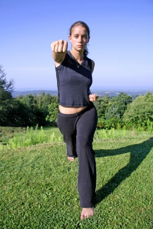 self defence: punch - attractive young woman practicing self defense