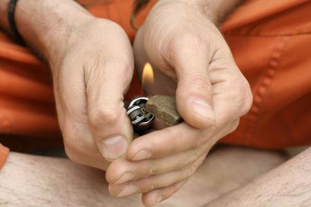 dope: hippy preparing, rolling and smoking marijuana joint : photos series