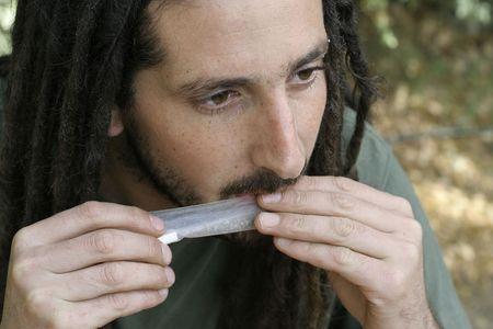 marihuana: hippy preparing, rolling and smoking marijuana joint : photos series