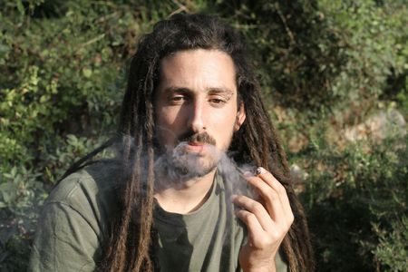 hippy preparing, rolling and smoking marijuana joint : photos series