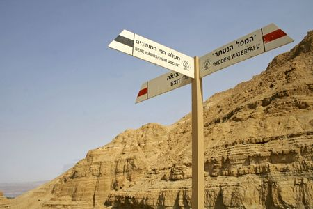 steep cliffs sign: road sign in desert landscape in the dead sea region