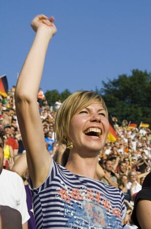 delirious: happy lady supporting her team