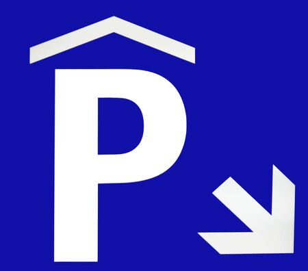 DOWN TOWN: underground parking sign on blue background Stock Photo