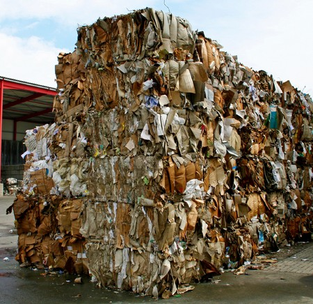 stack of paper waste before shredding at recycling plant in Germany Stock Photo