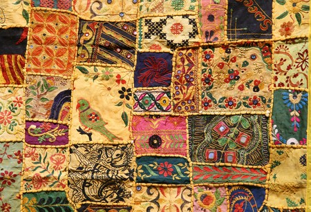 Indian patchwork wall cloth on display in Hampi market, India