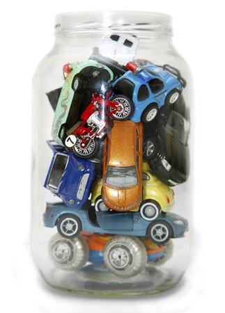 bottleneck: Traffic Jammed in transparent jar isolated on white background Stock Photo