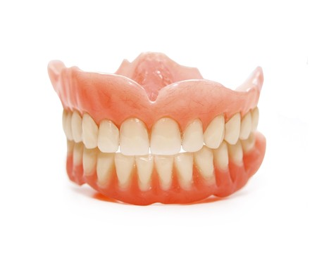 False teeth prosthetic on isolated white background