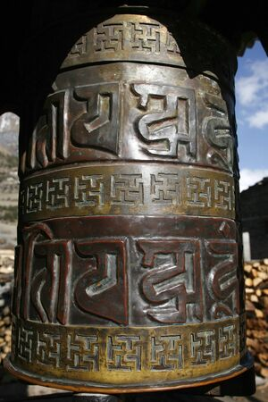 nepali: Traditional praying wheels at the entrance and exit of Nepali villagers on the Annapurna trail