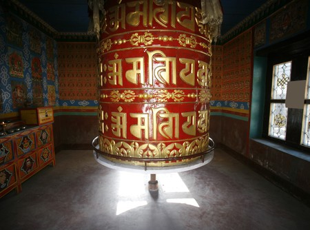 Large praying wheel in small temple on the annapurna circuit. photo