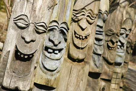 happy laughing faces carved out of wood