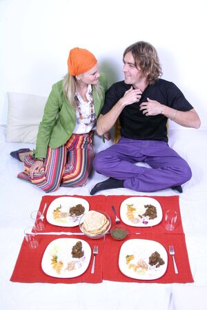 Young couple in their 20's eating on the floor in their living room Stock Photo - 4639256