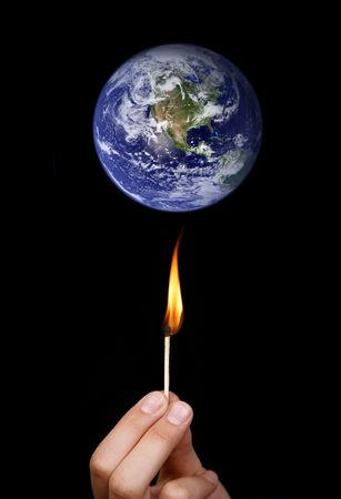 Global warming concept: match stick burning the world Stock Photo - 4639295