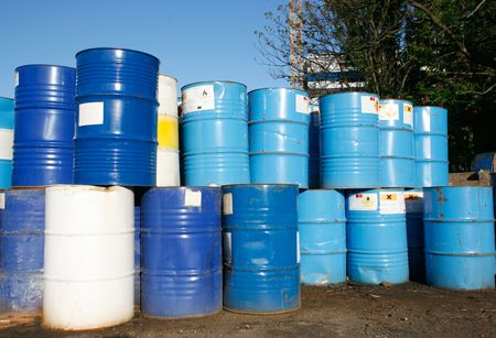 dump yard: Blue and white oil barrel container drums in junk yard